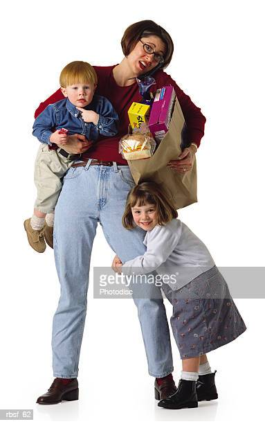 busy caucasian mom with groceries a telephone and kids