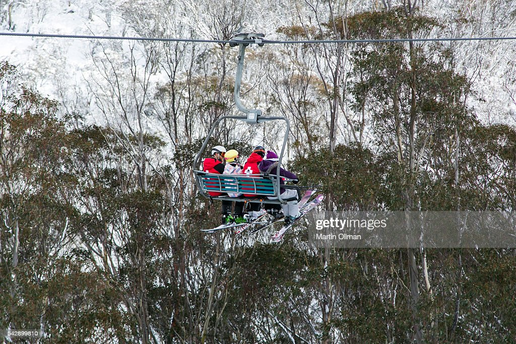 Busy chairlifts after fresh snowfall on the opening weekend of the season on June 25, 2016 in Thredbo Village Australia. Snow has been forecast across Eastern Australia as cold front continues to bring low temperatures, rain and potentially damaging winds.