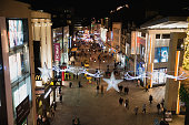 A high-angle view of a busy high street near Christmas time, people can be seen completing their Christmas shopping on a dark night in Newcastle, England.