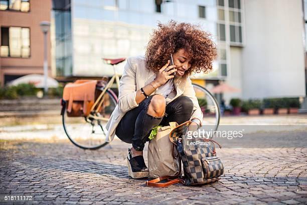 Busy city life. Multitasking modern woman