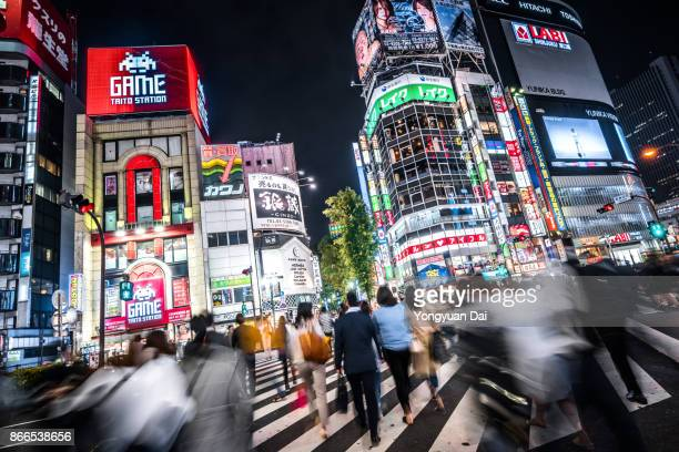 Busy Commuters in Shinjuku at Night
