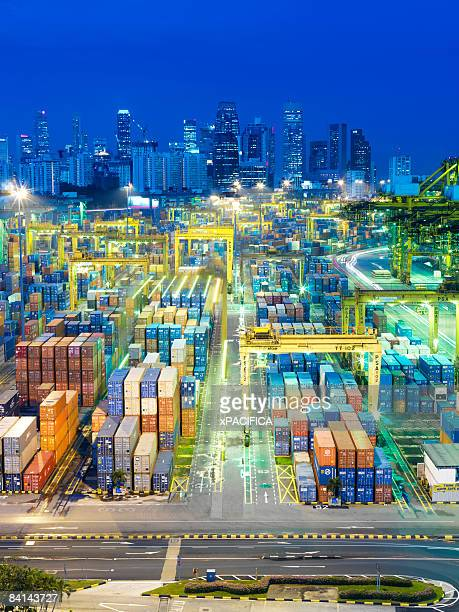 A busy container shipping terminal at night