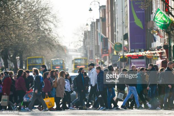 A busy crossing point on Bachelors Walk in Dublin's city center On Friday March 24 in Dublin Ireland
