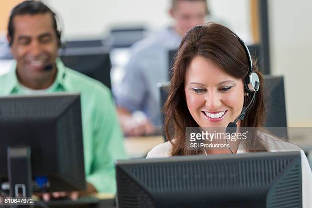 Busy customer service representative takes call from customer