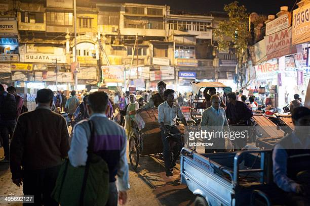 Busy Delhi market square at night