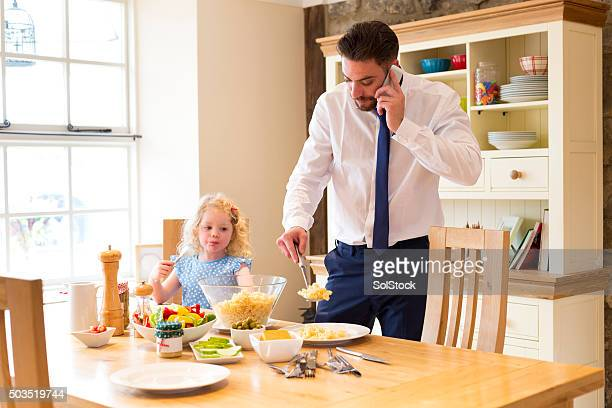 Busy father serving lunch before work.