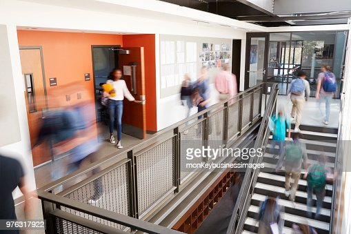 Busy High School Corridor During Recess With Blurred Students And Staff : Stock Photo
