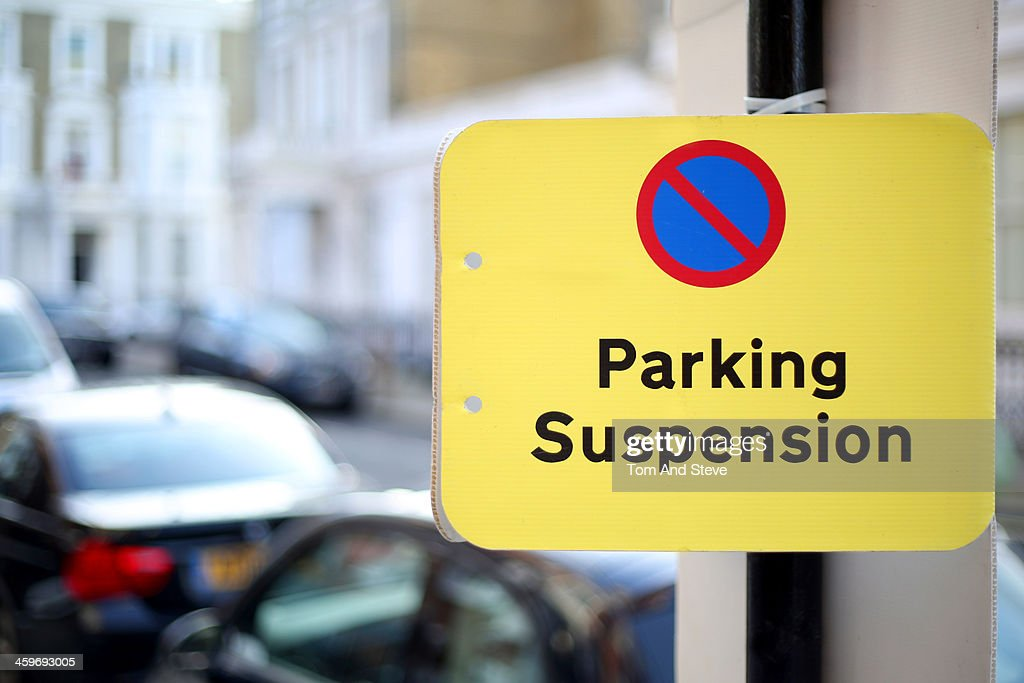 Busy London street with parking suspension sign