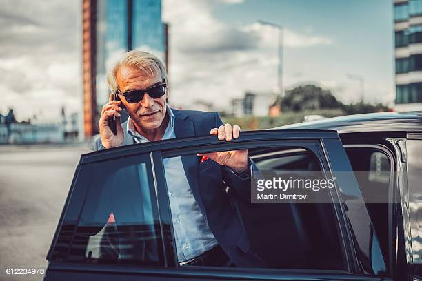 Busy man talking on phone