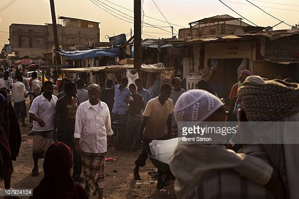 Busy market scenes in the AlBasateen urban refugee area Aden Yemen August 11 2010 Many of these people are part of a huge number of people making the...