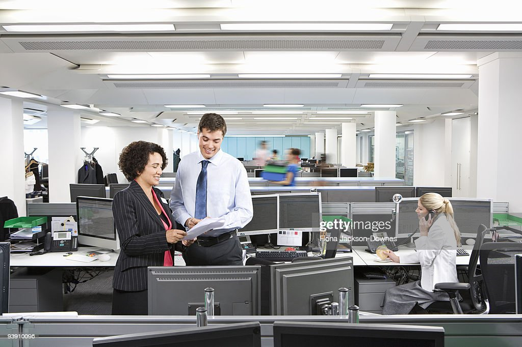 A busy modern office scene : Stock Photo