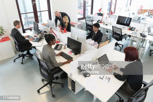 Busy modern office with people working at desks