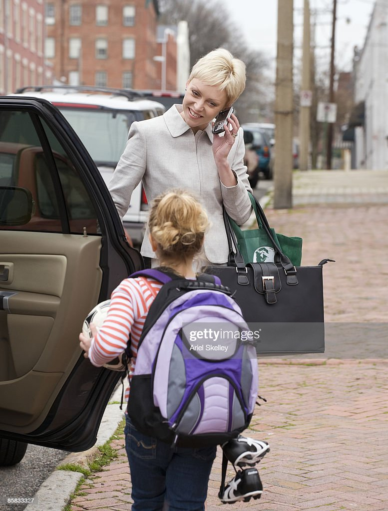 Busy Mother Taking Daughter to Soccer Game
