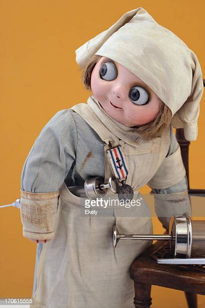 Busy nurse doll with syringes.
