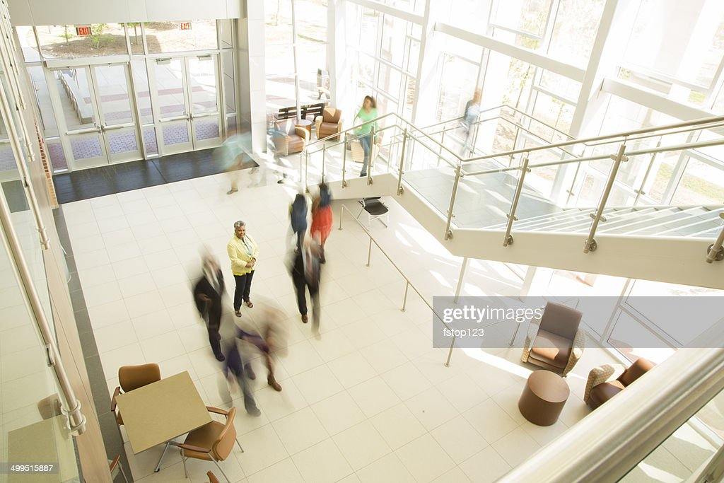 Busy people in business office, bank or shopping mall.