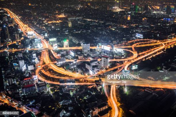 Busy Road Intersection at Night