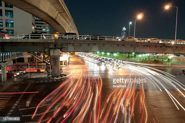 Busy Road Junction At Night Near Silom In Bangkok, Thailand