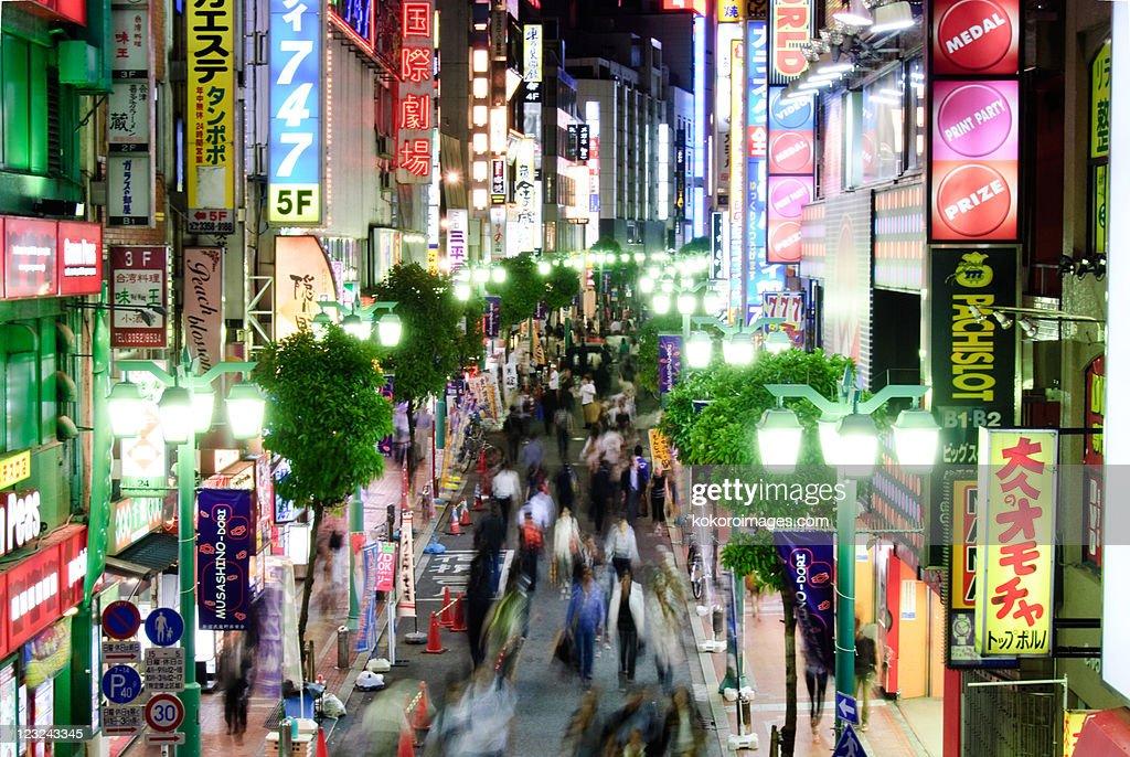 Busy Shinjuku street at night : Stock Photo