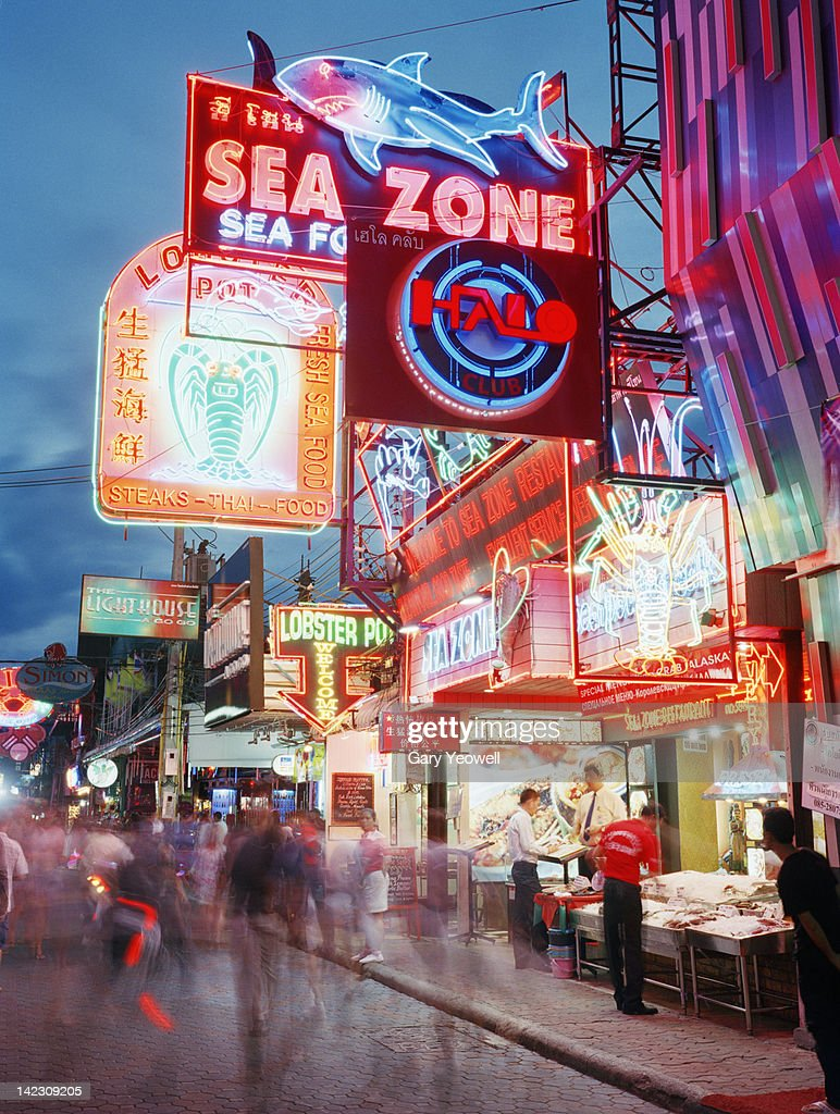 Busy street lit with neon signs : Stock Photo