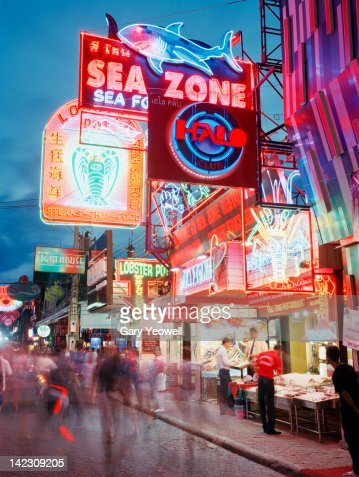 Busy street lit with neon signs