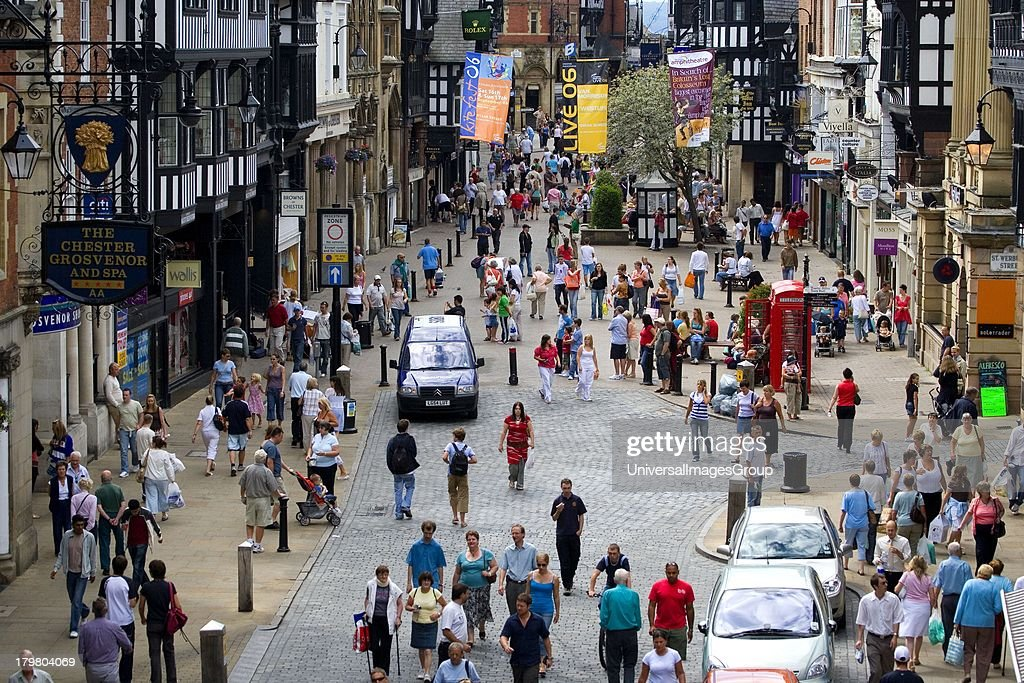 Busy street scene in city of Chester Cheshire England United Kingdom