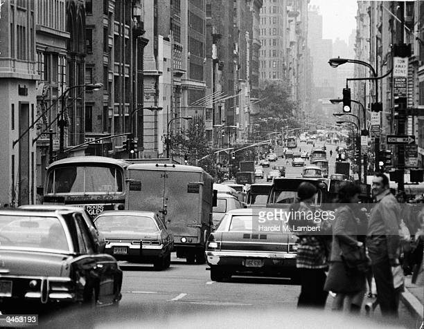 Busy street scene with traffic and pedestrians on West 35th Street Manhattan New York City 1970s