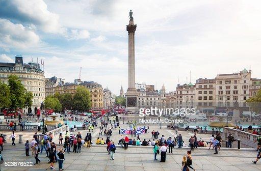 Busy Trafalgar Square London UK on sunny Autumn afternoon