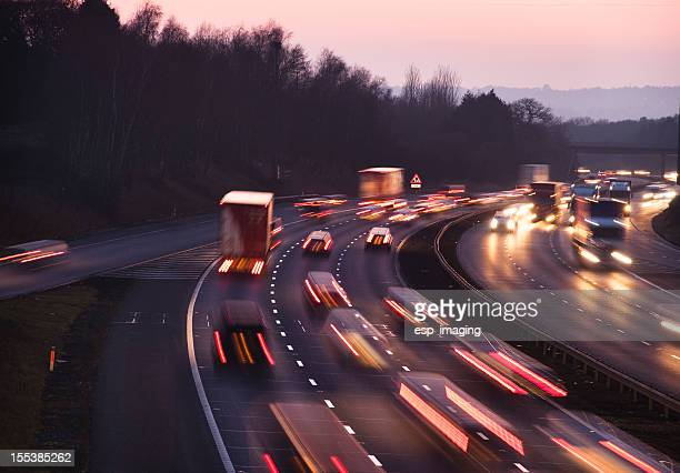 Busy traffic at dusk on the M42 Motorway near Birmingham