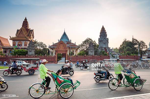 Busy Traffic Outside Wat Ounalom At Sunset In Phnom Penh