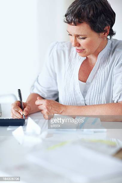 Busy woman calculating taxes