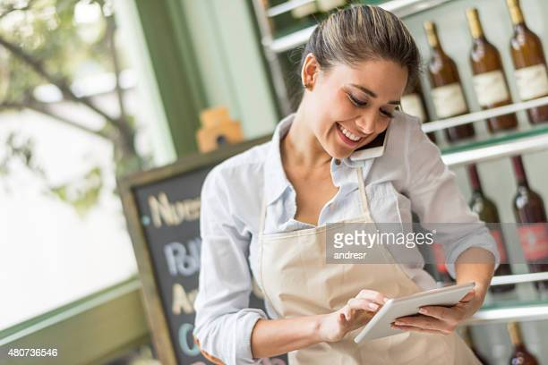 Busy woman working at a restaurant multitasking