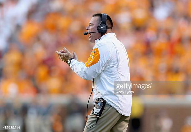 Butch Jones the head coach of the Tennessee Volunteers gives instructions to his team against the Oklahoma Sooners during the game at Neyland Stadium...