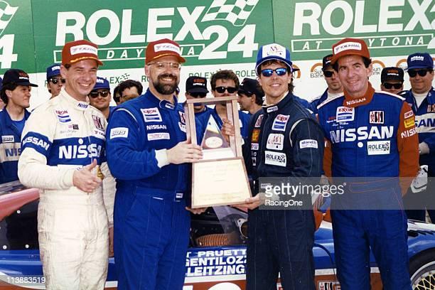 Butch Leitzinger Paul Gentilozzi Scott Pruett and Steve Millen enjoy their moment in Daytona International Speedway's victory lane after the quartet...