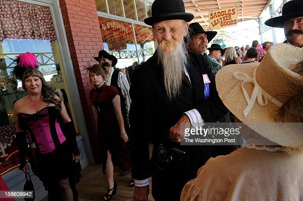 Butch Shimer of Barstow CA center stands with others who dressed the part for Wyatt Earp Days on Saturday May 26 2012 in Tombstone AZ The event...