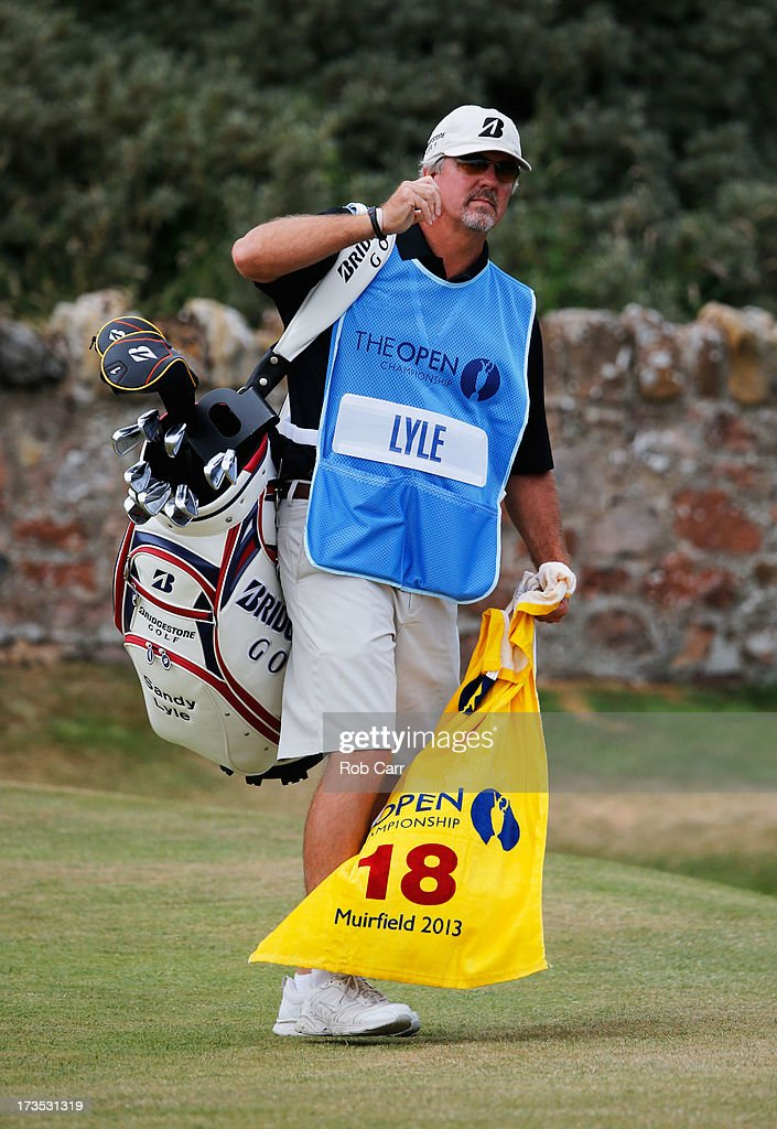 Butch Wilhelm, the caddie for Sandy Lyle of Scotland, pulls out a towel ahead of the 142nd Open Championship at Muirfield on July 16, 2013 in Gullane, Scotland.