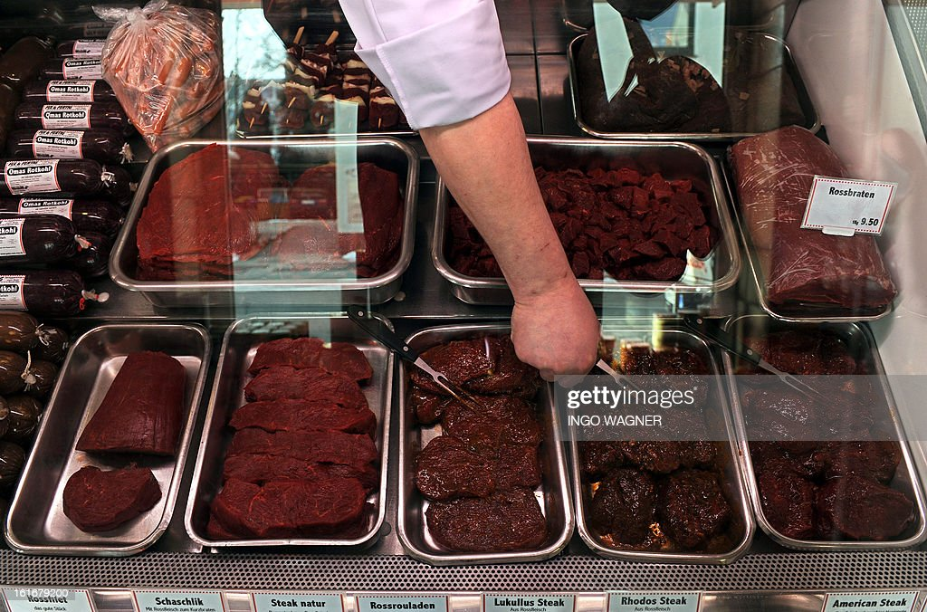 A butcher arranges different sorts of horse meat on sale at his shop in Bremen, northern Germany on February 14, 2013. The scandal over horsemeat-tainted food spiraled after Britain announced the discovery of a potentially harmful drug in horsemeat sent to France and Germany.
