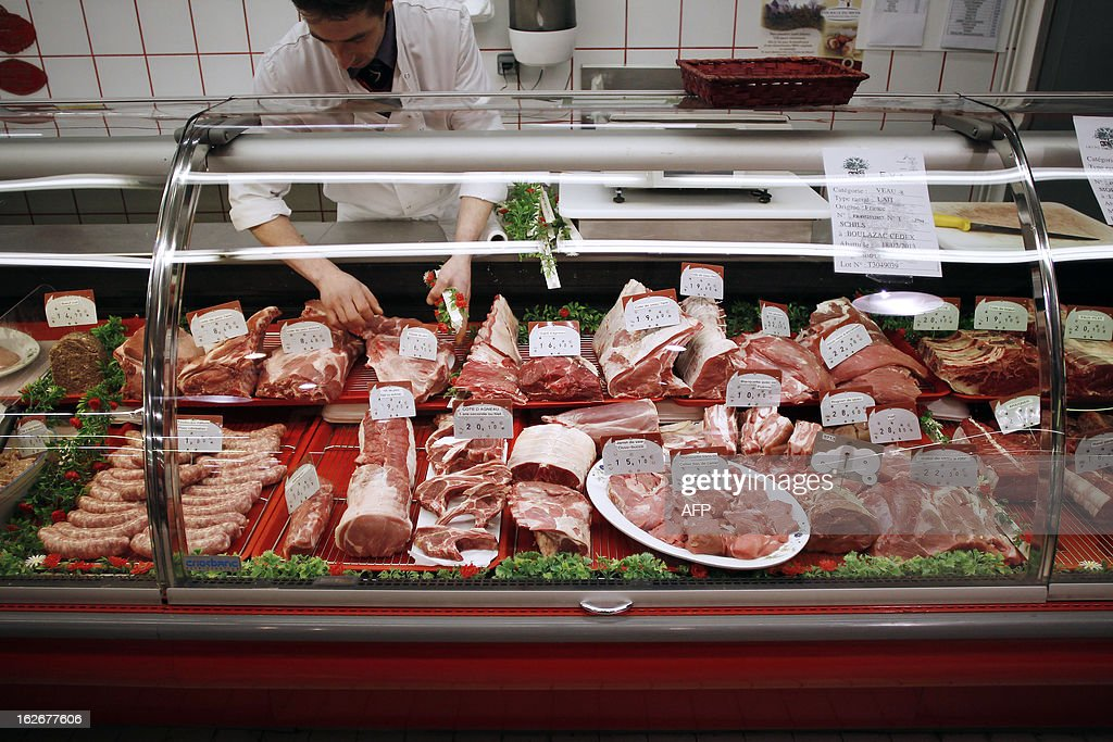 A butcher arranges his stand at a supermarket in Herouville Saint-Clair, northwestern France, on February 26, 2013. A Europe-wide food fraud scandal over horsemeat sold as beef emerged in mid-January when Irish authorities found traces of horse in beefburgers made by firms in Ireland and Britain and sold in supermarket chains including Tesco and Aldi. The scandal intensified earlier this month when Comigel -- a French frozen meal maker which bought 500 tonnes of mislabelled horsemeat from Spanghero -- alerted Findus to the presence of horsemeat in the meals it had made for the food giant and which were on sale in Britain.