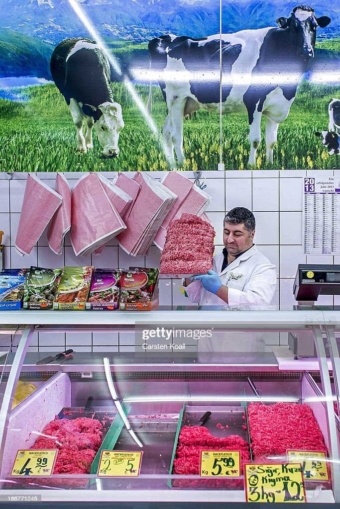 A butcher carries a full plate of meat behind the counter in the Turkish supermarket Marketler at Karl-Marx-Strasse in Neukoelln district on November 02, 2013 in Berlin, Germany. According to recently published statistics, 7.2 million foreigners were living in Germany by the end of 2012, which is the highest number ever recorded. Of those 80% are from countries in the European Union, while the rest come primarily from Turkey, Russia, the former Soviet states and Arab countries.