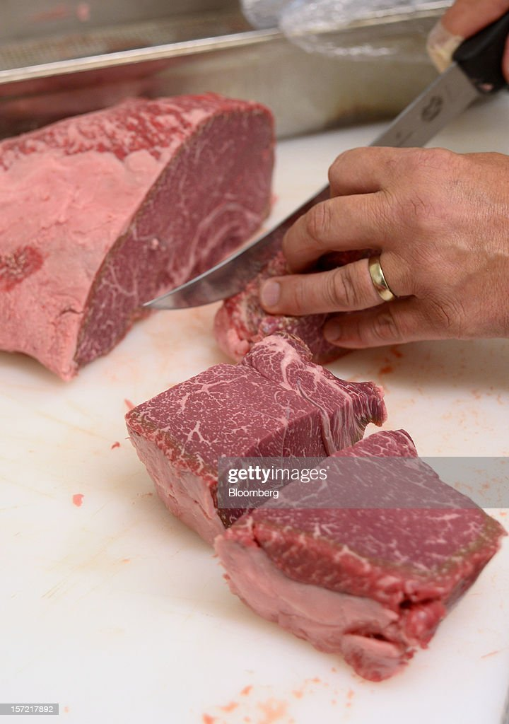 Butcher Glenn Watson cuts Blackmore Wagyu beef into 240-gram portions at Rockpool Bar and Grill restaurant in Melbourne, Australia, on Tuesday, Nov. 27, 2012. The Australian Bureau of Statistics is expected to release November inflation data on Dec. 3. Photographer: Carla Gottgens/Bloomberg via Getty Images