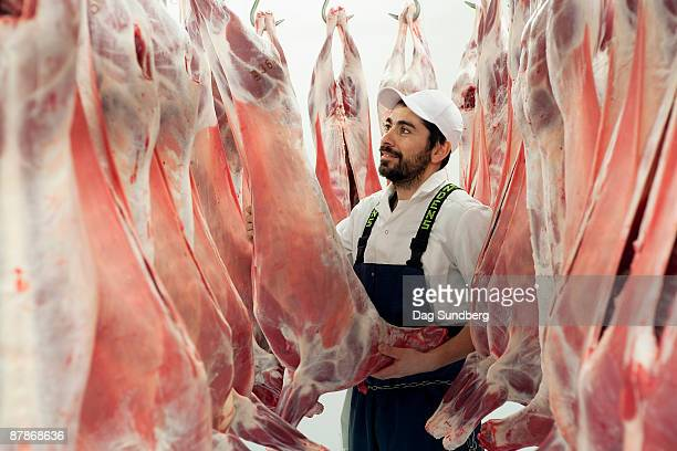 Butcher in abattoir with ecological meat