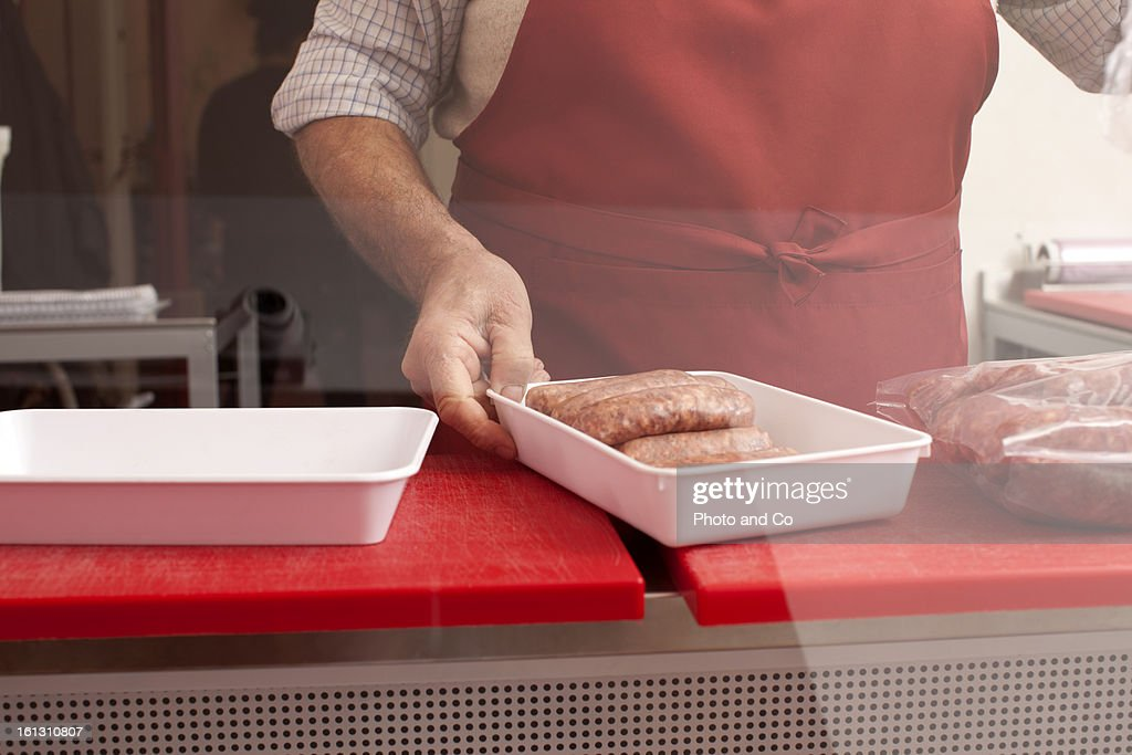 butcher in his shop : Stock Photo