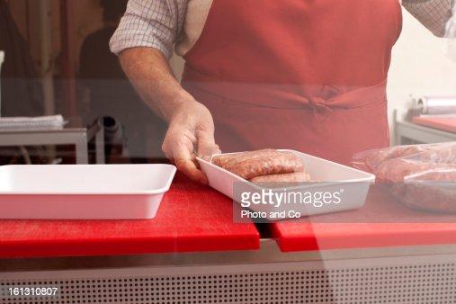 butcher in his shop : Foto de stock