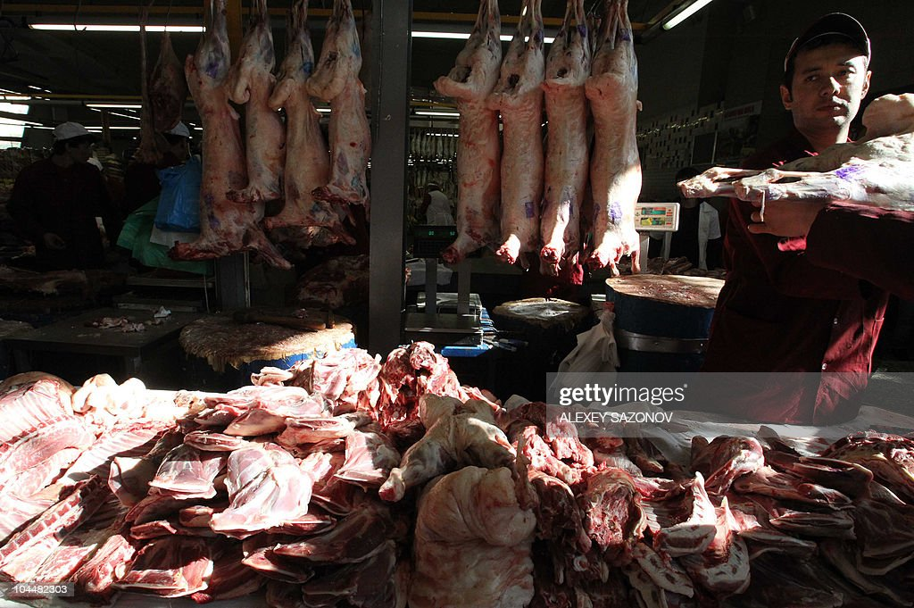 A butcher prepares meat at the Dorogomilovsky Market during a 'slow food' farmers' festival in Moscow on September 25 2010 AFP PHOTO / Alexey SAZONOV