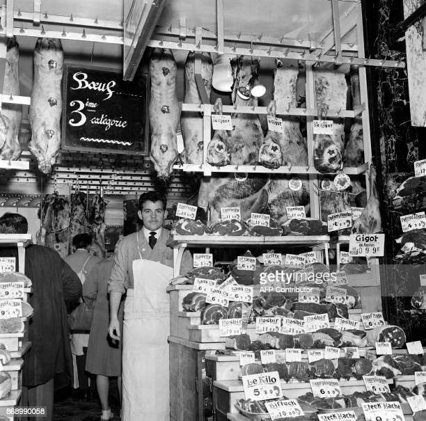 A butcher presents the new price ticketing on November 21 1961 in a Parisian butcher's shop enforcing the decree of the secretary of state for...