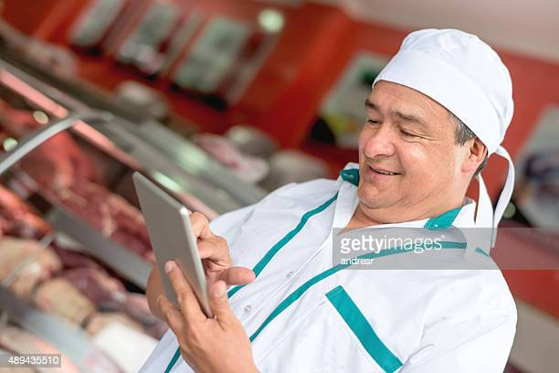 Butcher using technology at his small business