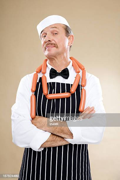 Butcher Wearing String Of Sausage Links