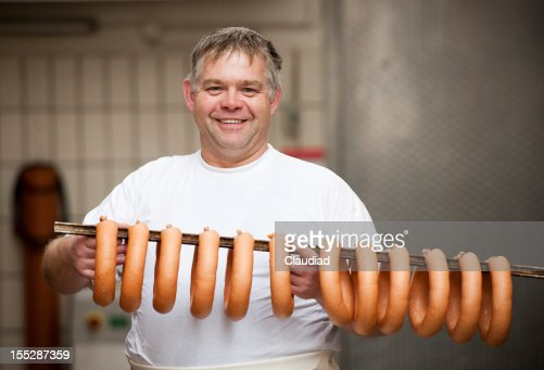 Butcher with fresh sausages