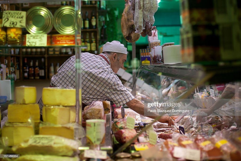 A butcher works at a delicatessen on December 3, 2012 in Madrid, Spain. Spain has formally requested 39.5 billion euros of European funds to bailout a number of its struggling banks.