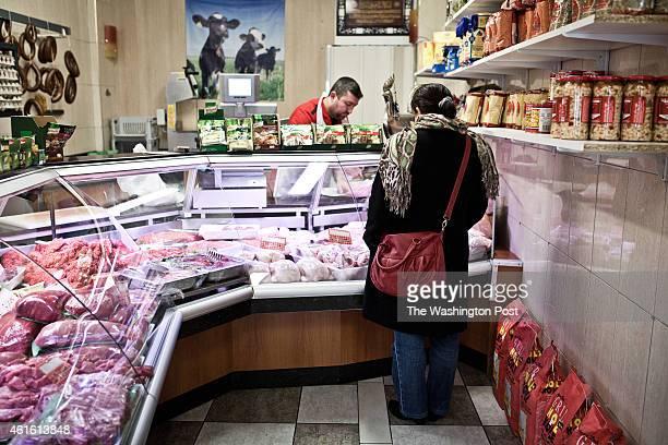 Butchers inside the Kasap Mehmet butchery in a street near the Annasr Mosque on January 13 2014 in Vilvoorde