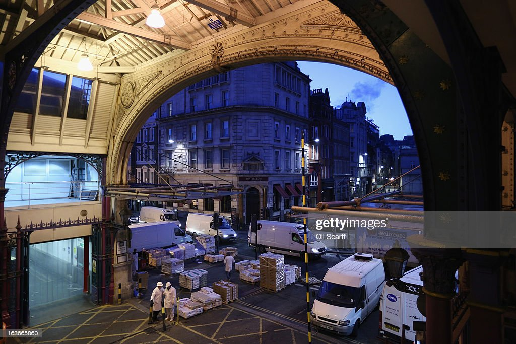 Butchers prepare to deliver meat for sale in Smithfield Market on March 14, 2013 in London, England. Smithfield Market, which is officially named the 'London Central Markets', has been the site of a livestock market since the Twelfth Century. Located in the City of London, the market's Victorian buildings were designed by Sir Horace Jones, the City Architect, and were completed in the 1860s. Developers have recently proposed a 160 million GBP refurbishment of the derelict western end of Smithfield Market into an artisan food centre known as 'Smithfield Quarter'.